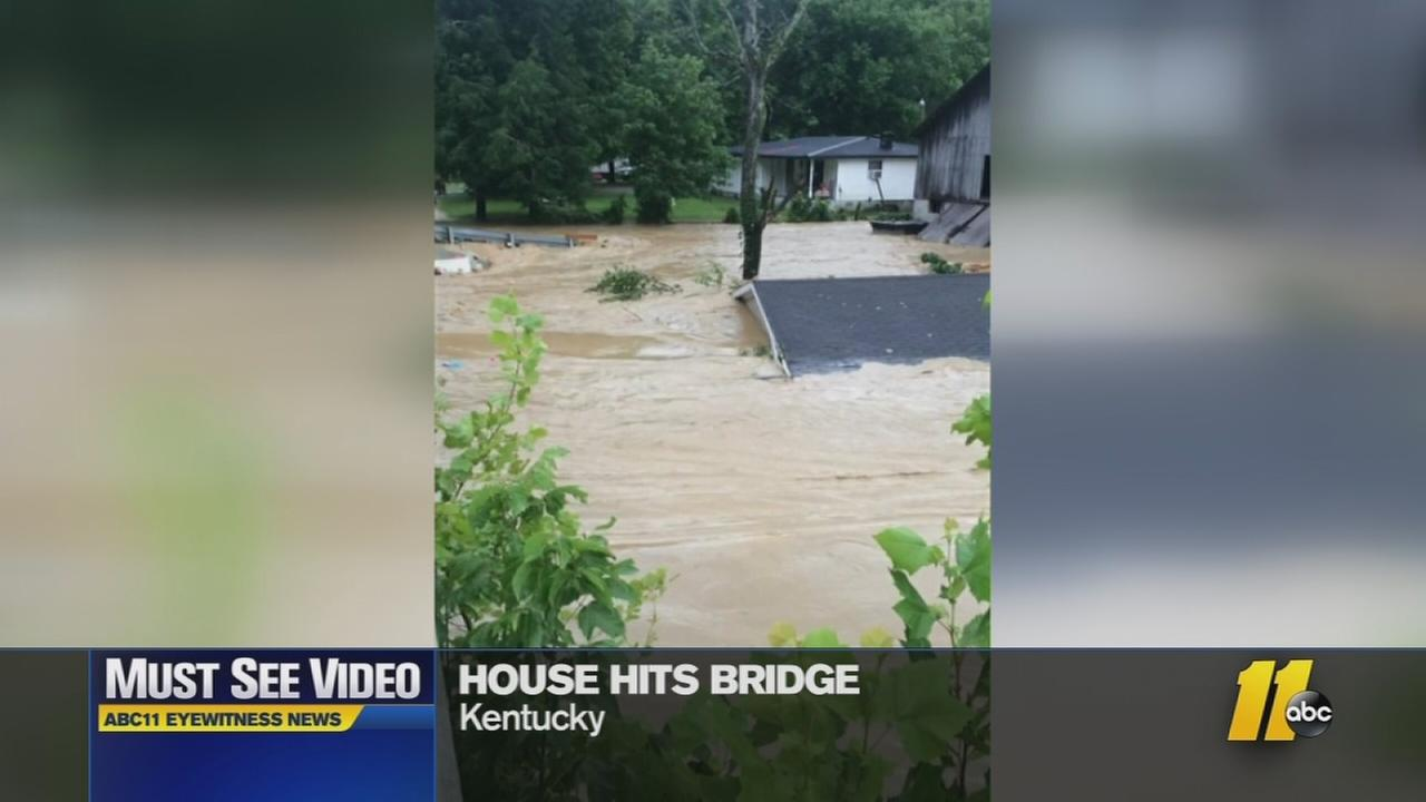 House floats away down river