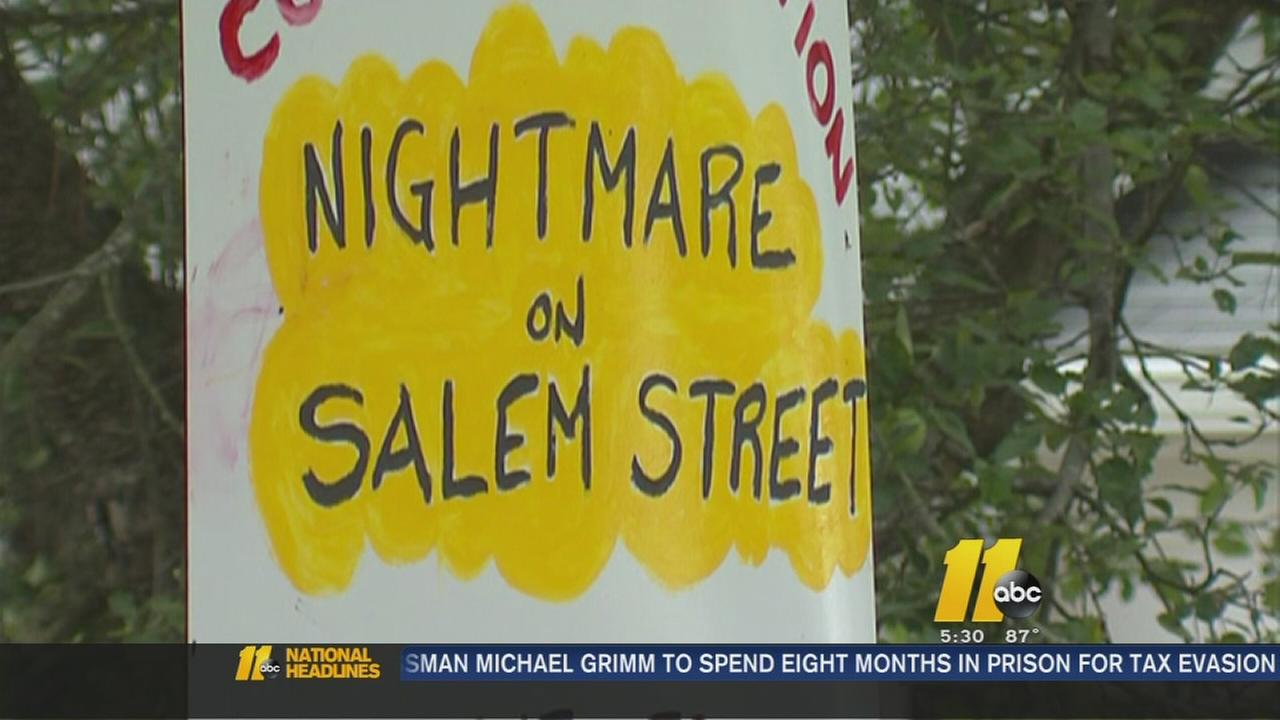 Homeowner erects signs critical of school, construction