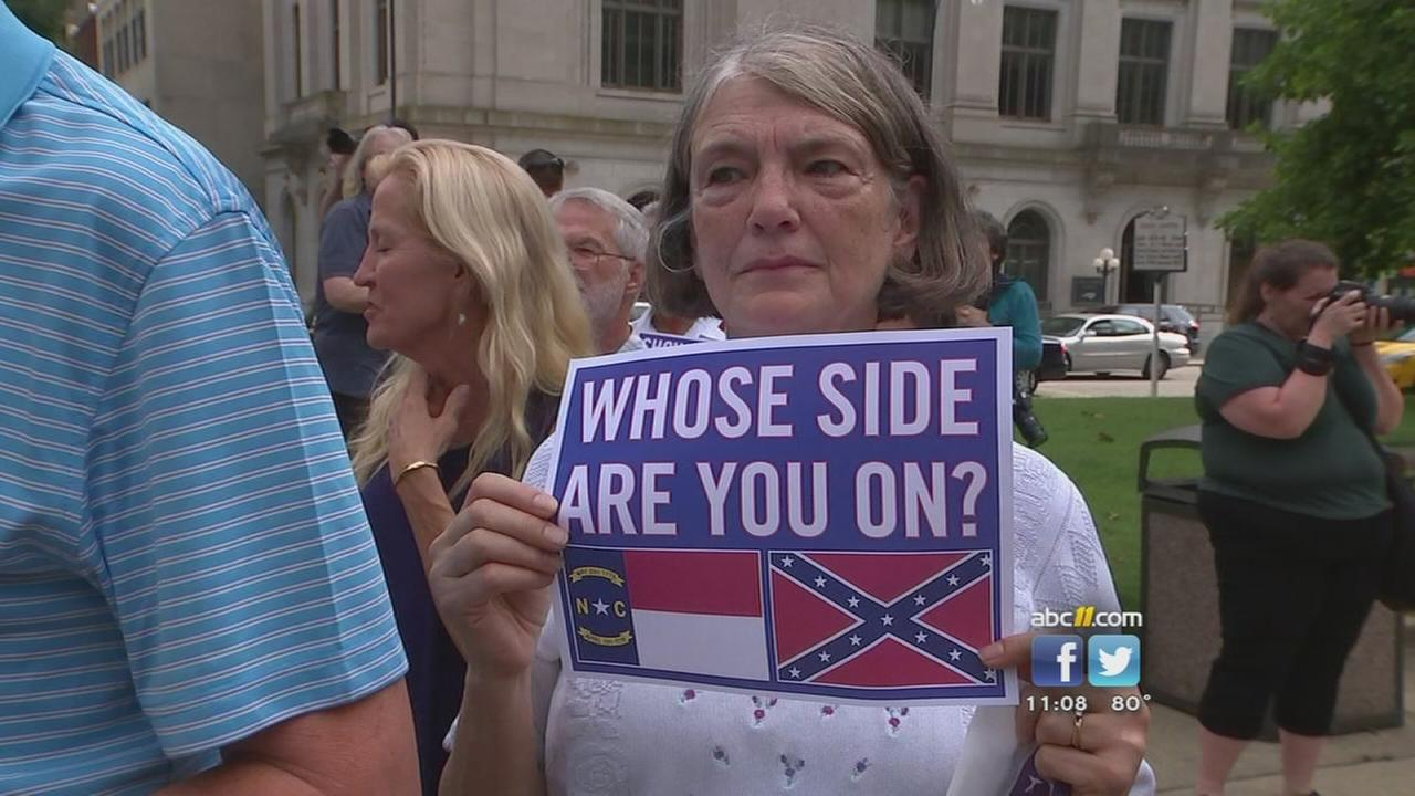 Protesters take aim at law about Confederate monuments