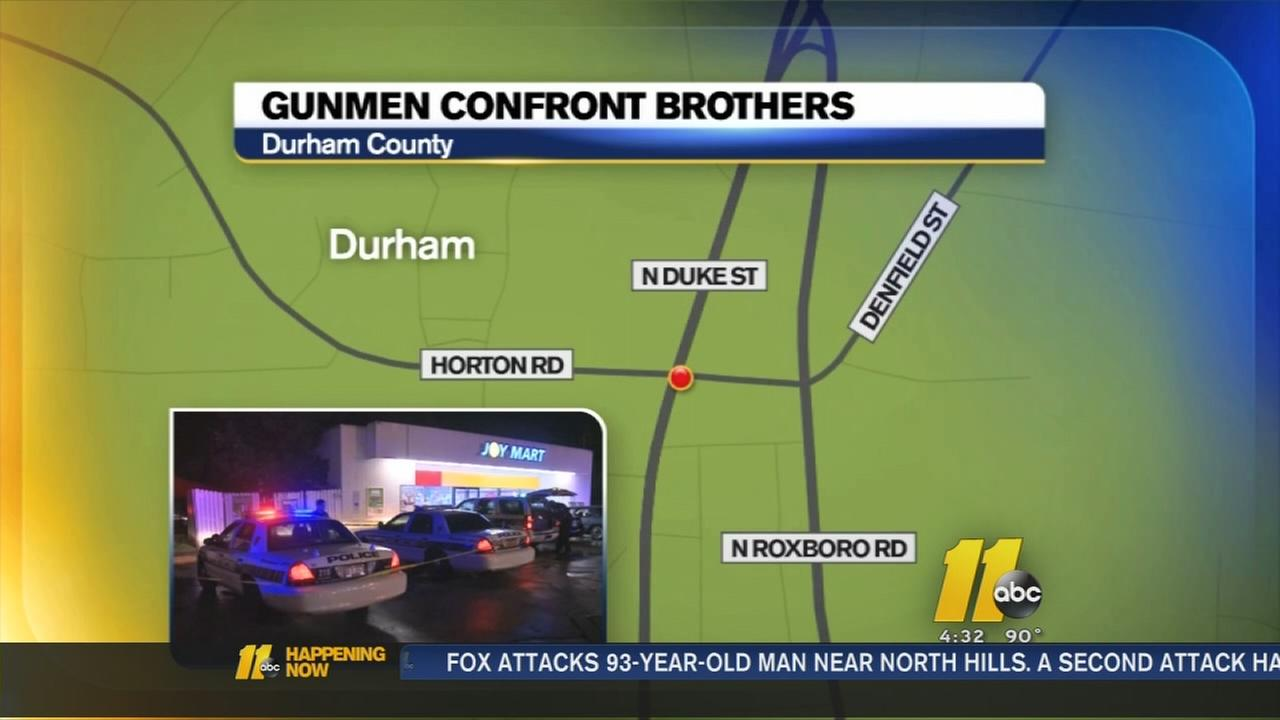 Gunman confront brothers