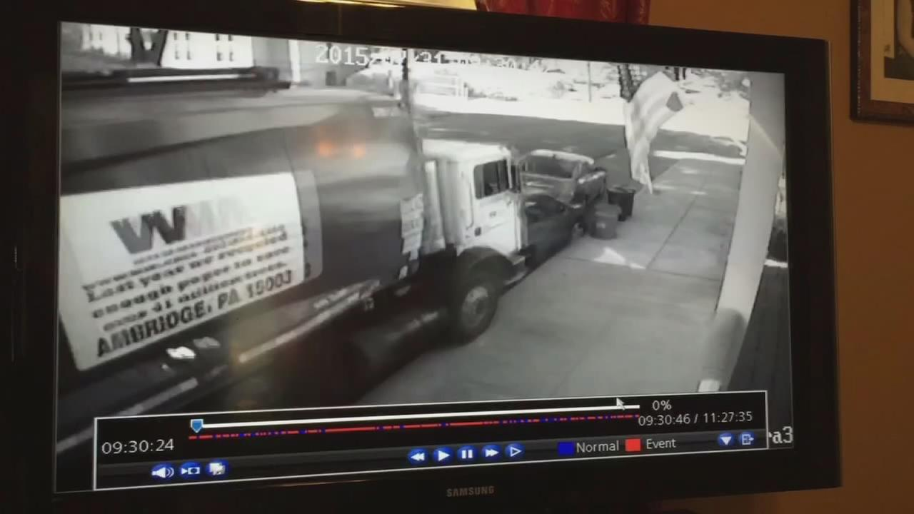 Runaway garbage truck plows through cars