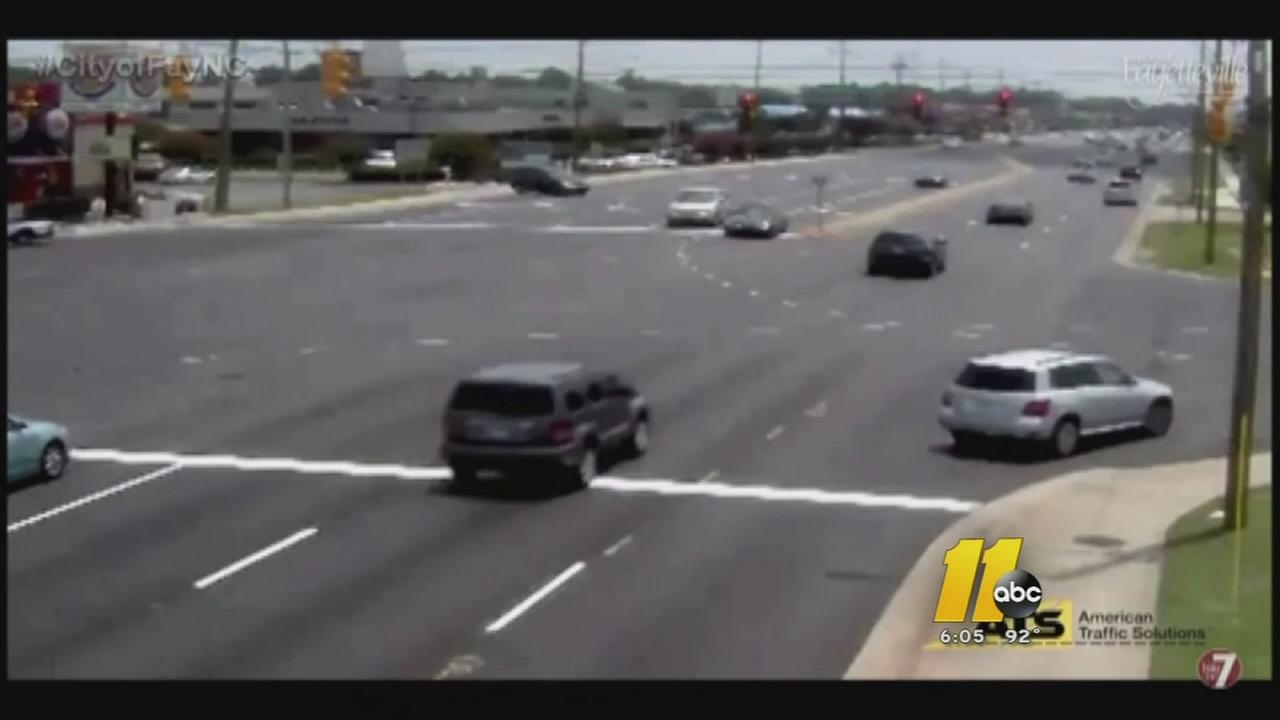 Red light cameras show drivers speeding through intersections