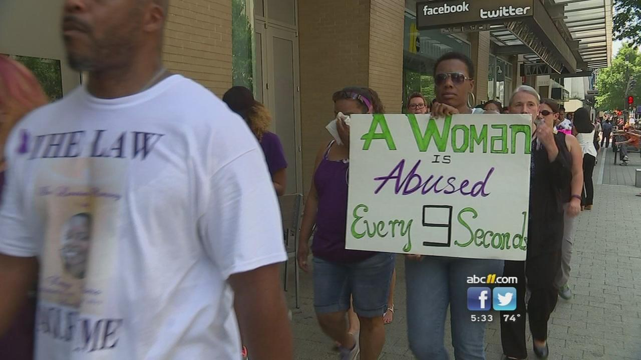 Shooting victims family joins domestic violence rally