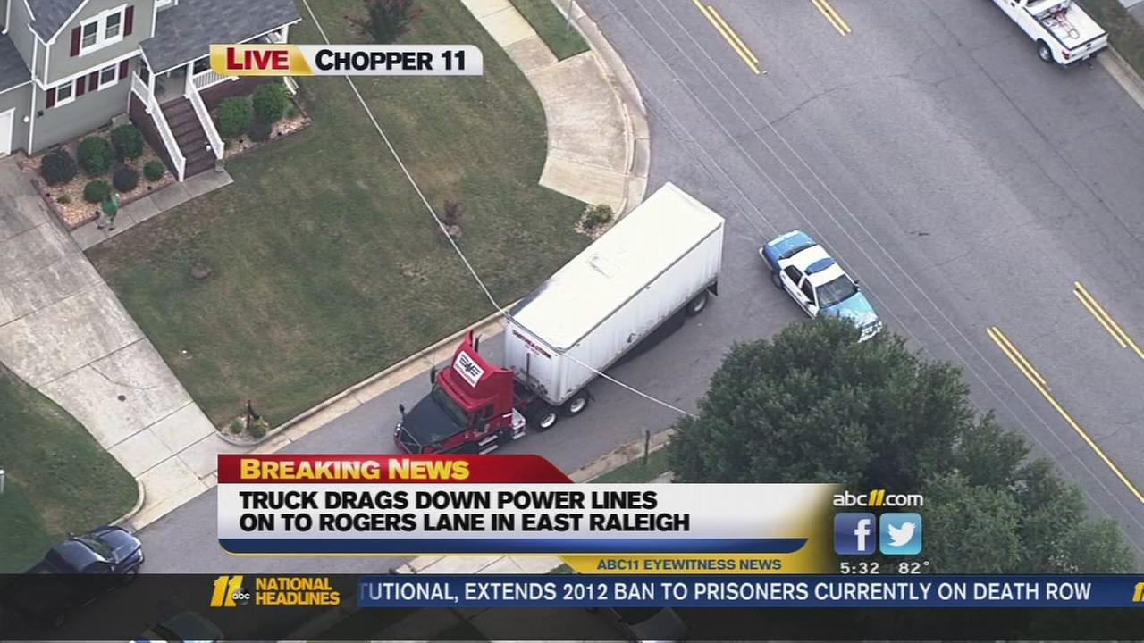 Truck drags down power lines
