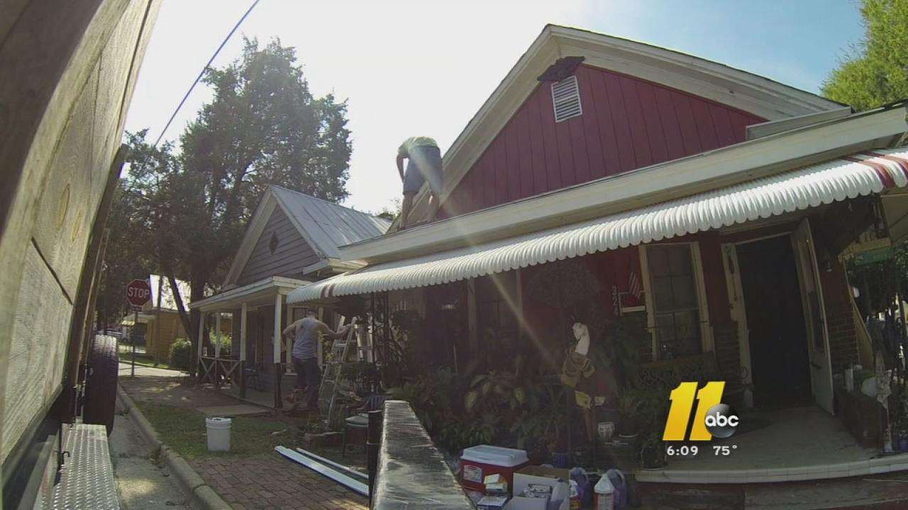 Dozens help out on the home of a widowed woman