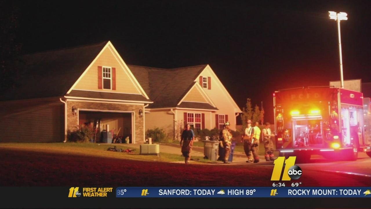 Mother rushes into burning home to rescue kids
