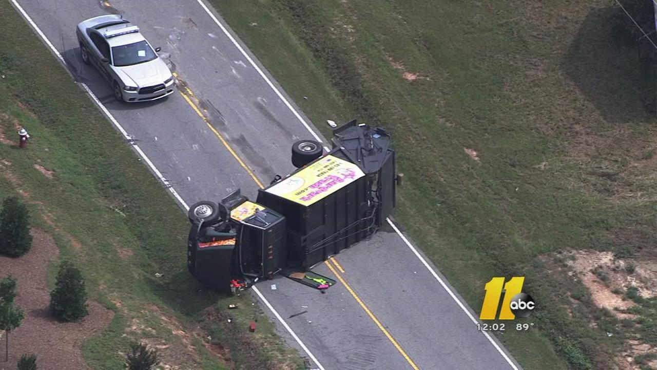 Garbage truck flips in Johnston County