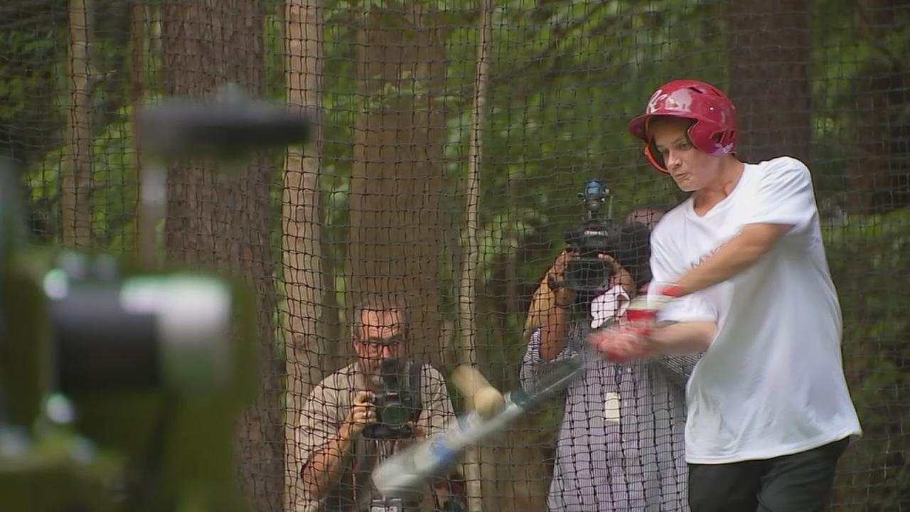 Teen fighting cancer has batting cage in backyard