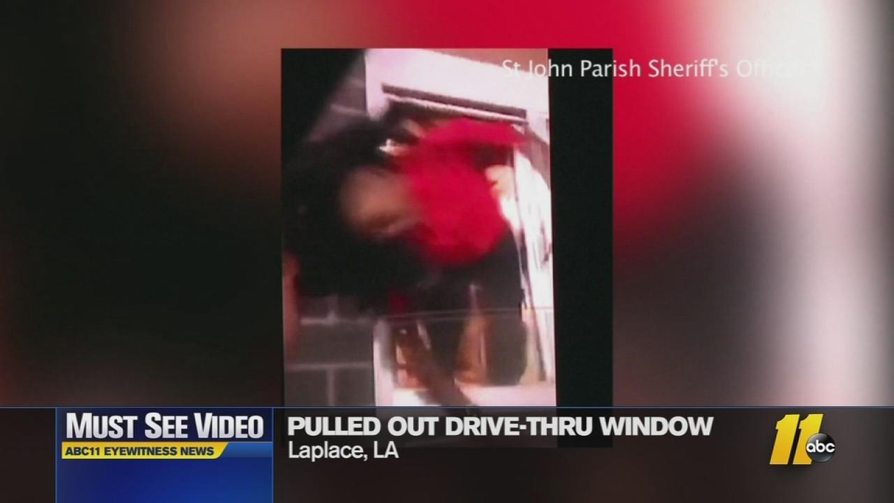 Must-see video: Teen pulled out of drive-thru window