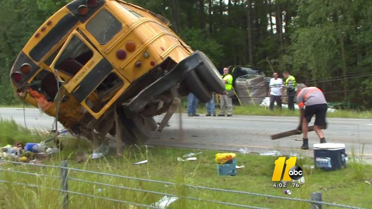 Driver charged in bus accident that injured 26 on US 64