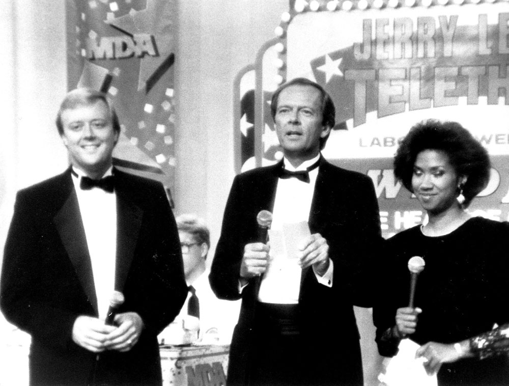 <div class='meta'><div class='origin-logo' data-origin='none'></div><span class='caption-text' data-credit=''>Larry Stogner with co-anchor Miriam Thomas and sports anchor Ron Savage at the Jerry Lewis Telethon.</span></div>