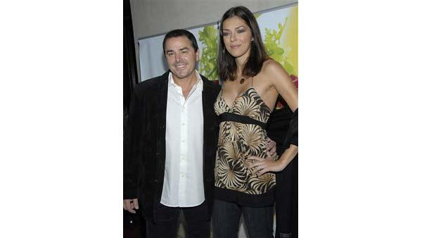Actor Christopher Knight, left, and model Adrianne Curry pose on the press line at the Sashi restaurant opening in Manhattan Beach, Calif. on Aug. 28, 2008. Okuwa is best known for his appearance on the television series 'Iron Chef'.