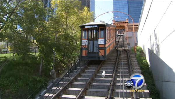 The Angels Flight railway climbs a 33-percent incline and both cars share a common middle rail, except in the middle of the route where they pass as one ascends and the other descends.
