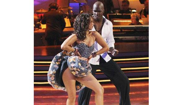 NFL wide receiver Chad Ochocinco and partner Cheryl Burke perform the Cha Cha Cha on the season premiere of 'Dancing With the Stars.'