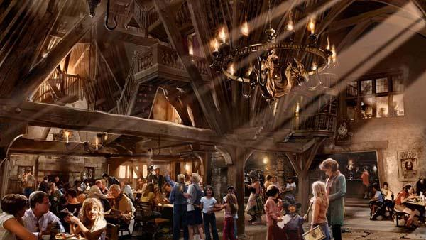 The Three Broomsticks and adjacent Hog's Head pub will feature traditional British fare and drinks including Butterbeer and pumpkin juice. (Early conceptual rendering of The Three Broomsticks, located in Hogsmeade)