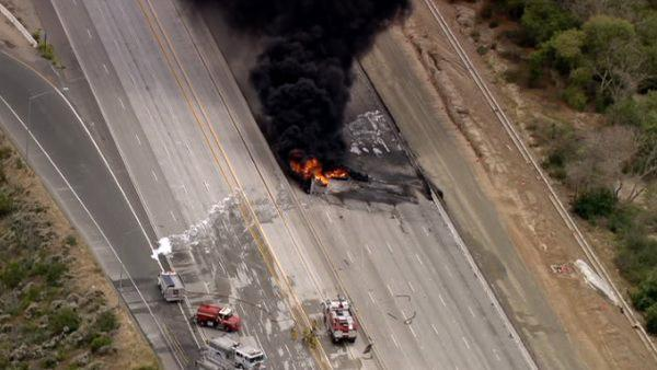 A tanker truck overturned and exploded on the 91 Freeway in Corona on Friday, shooting flames over 100 feet in the air.