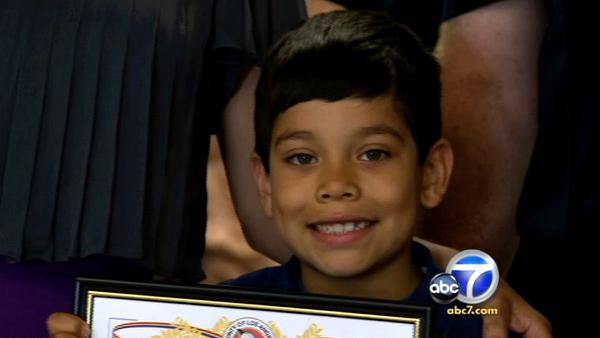 7-year-old boy saves babysitter's life