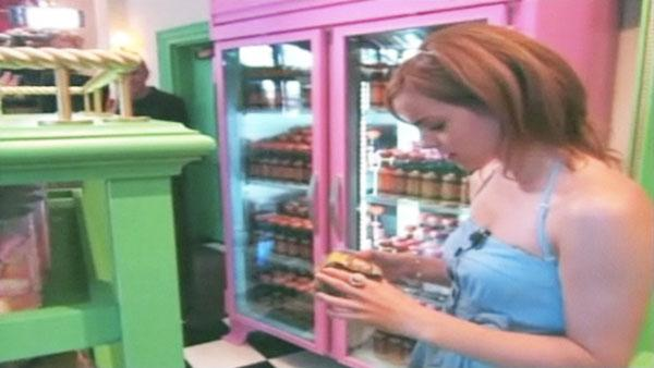 Emma Watson (Hermione Granger) examines candy at 'The Wizarding World of Harry Potter,' which opened at Universal Studios in Orlando, Florida on June 18, 2010.