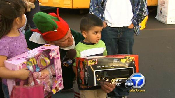 Kids help Stuff-A-Bus by bringing toys