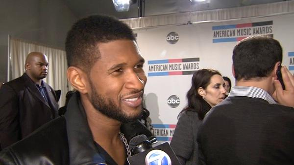 Usher speaks backstage at the 2010 American Music Awards in Los Angeles.