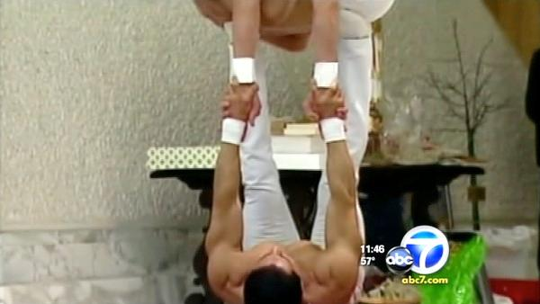 Acrobats tear shirts off in front of Pope