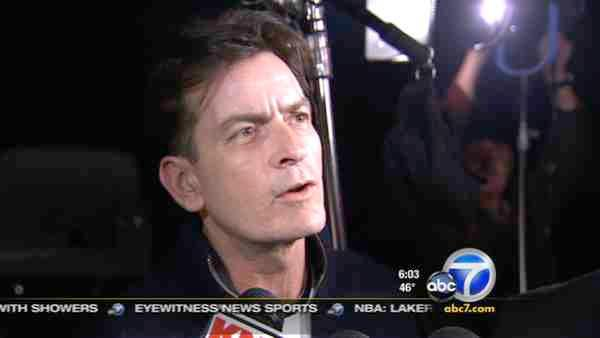 Charlie Sheen's two twin boys were removed from his house in a court-ordered move by his estranged wife.
