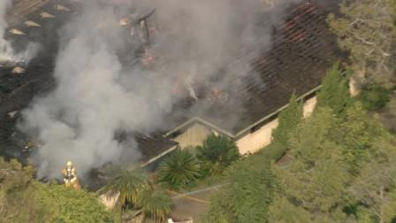Los Angeles County Fire was called to a home in Whittier with a report of flames showing from the roof.