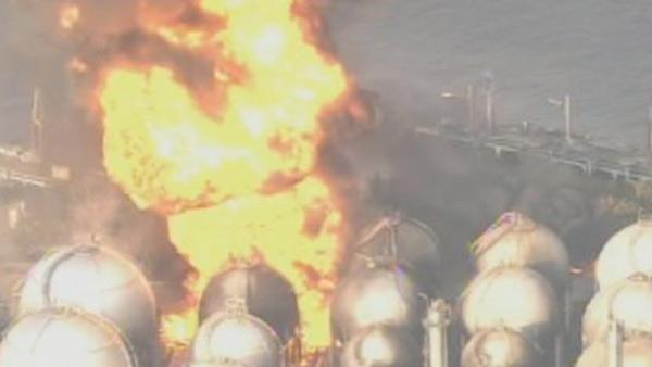 Fire burns at Japan refinery after huge quake