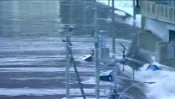 TV footage shows cars being washed away after a tsunami hits following the massive earthquake in Japan on Friday.