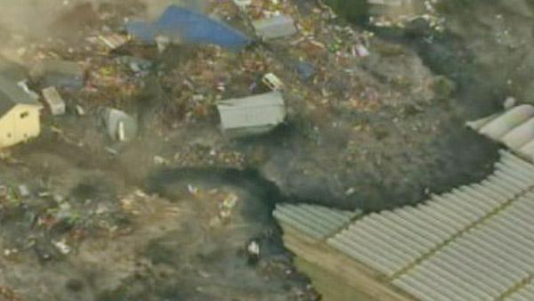 Aerial footage in Japan shows a tsunami wave washing away everything in its path following a huge earthquake.