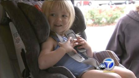 A child is shown sitting in a car seat in this undated file photo.