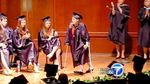 Teen walks for first time during graduation