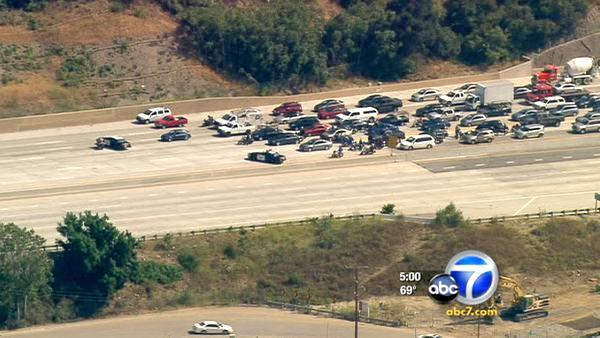 Suspicious vehicle spurs evacs, fwy closure