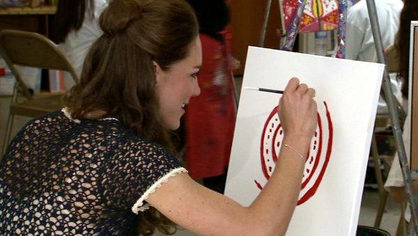 Kate, also known as Catherine, Duchess of Cambridge, is painting alongside children at Inner-City Arts in d