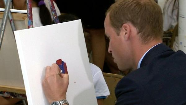 Prince William is painting alongside children at Inner-City Arts in downtown Los Angeles Sunday July 10, 2011.