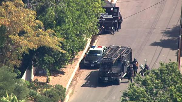 Suspect barricaded in large Northridge home