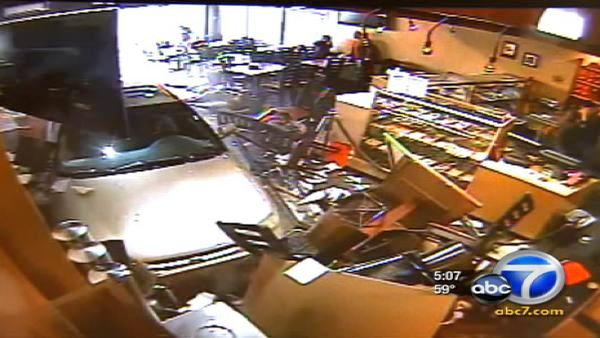 Car plows into restaurant, injures three people
