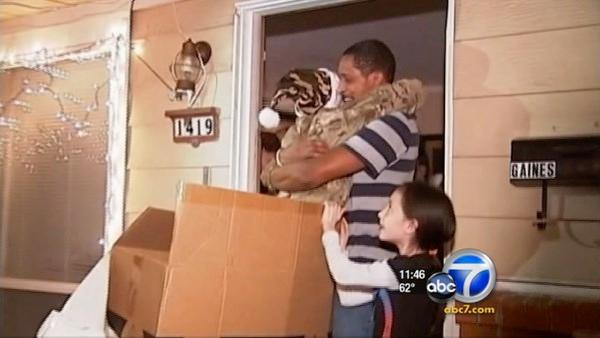 Soldier pops out of box, surprises family