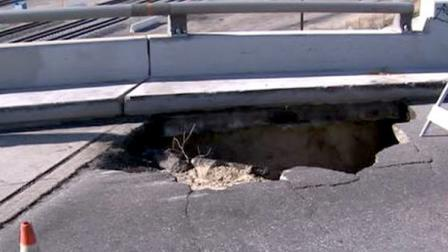 A 15-foot sinkhole at Mt. Vernon Ave. in Colton caused vehicle damage and traffic trouble; more delays expected Tuesday.