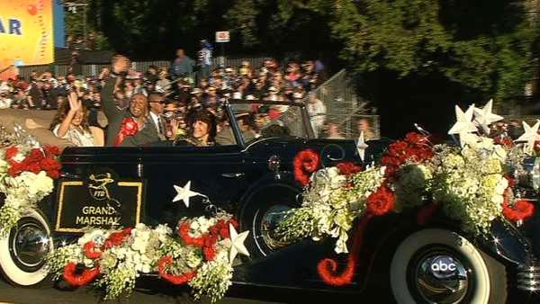 Grand Marshall J.R. Martinez waves to the crowd on Orange Grove Boulevard during the 123rd annual Rose Parade in Pasadena Jan. 2, 2012.