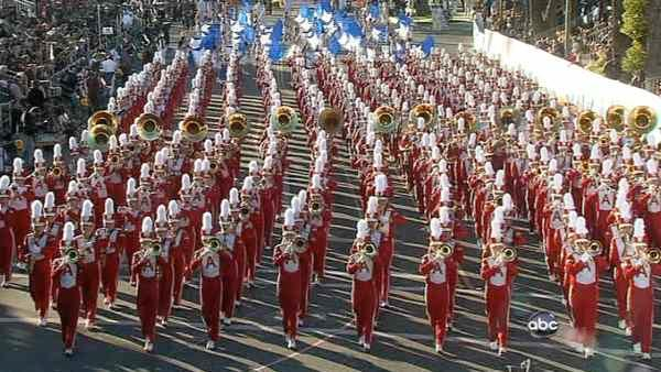The Arcadia High School marching band passes the crowd on Orange Grove Boulevard during the 123rd annual Rose Parade in Pasadena Jan. 2, 2012.