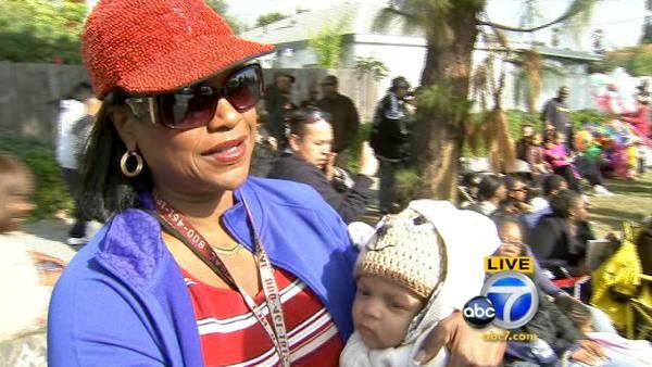 Woman brings grandson to Kingdom Day Parade
