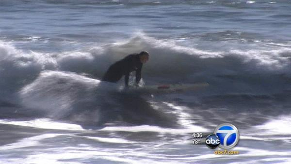 Huntington Beach surfers enjoy high surf