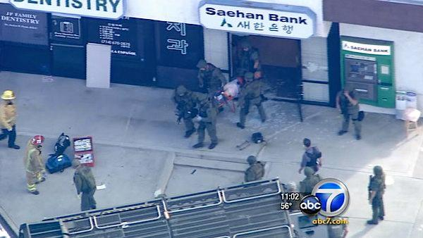Bank hostage suspect shot; manager rescued