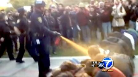 A UC Davis campus police officer is seen pepper-spraying demonstrators in Nov. 2011.
