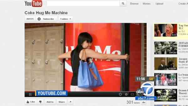 Coca-Cola machine gives free drinks for hugs