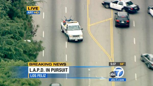 The tow truck driver pulled a U-turn in busy traffic on Los Feliz Blvd. About 12 LAPD cruisers were in pursuit on surface streets. The tow truck driver avoided any freeway.