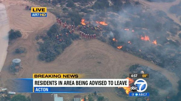 A brush fire erupted in Acton near Sole