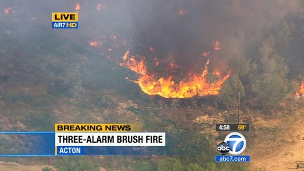 A brush fire erupted in Acton near Soledad Can