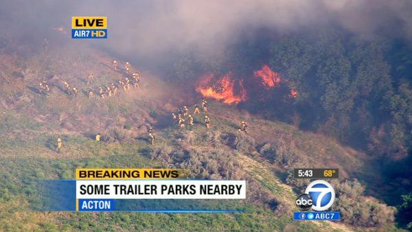 A brush fire erupted in Acton near